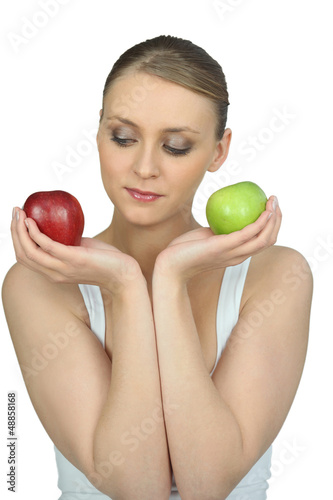Woman holding two apples