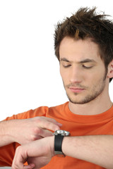Man tapping his watch