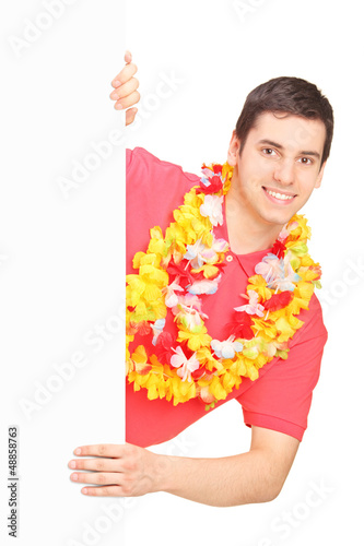 Smiling man wearing Hawaiian lei and posing on a panel