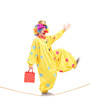 Full length portrait of a clown holding a bag and walking on a r
