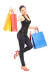 Happy young female with shopping bags