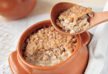 Wooden spoon with barley porridge