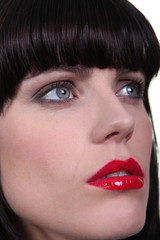 Woman wearing bright red lipstick
