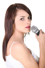 young brunette woman singing