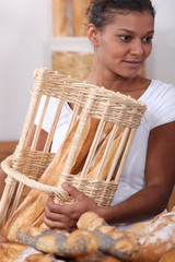 Woman with baguettes