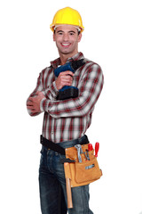 A construction worker posing with a drill.