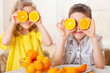 Children with oranges