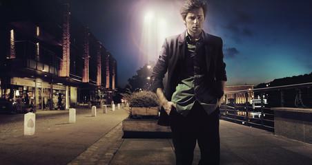 Sad man walking alone at the night