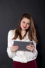 girl holding a tablet computer
