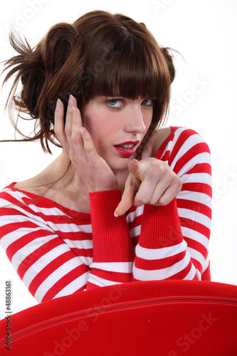 Fashionable woman pointing her finger
