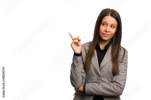 Business woman pointing aside with a critical look at someone