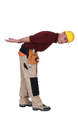 Builder bending over