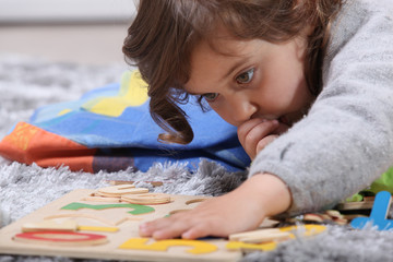 Child playing with a puzzle