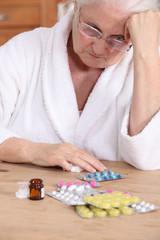 Elderly woman with medicine