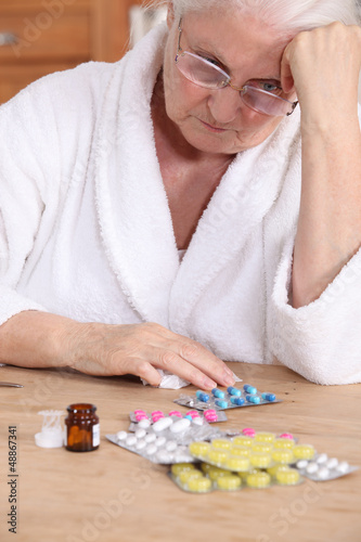 Elderly woman with medicine