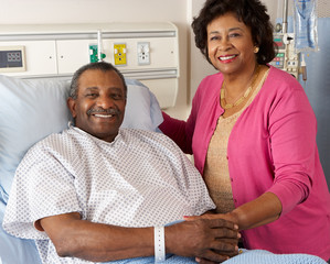 Senior Wife Visiting Husband On Ward