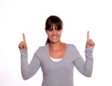 Smiling young woman with fringes pointing up poster