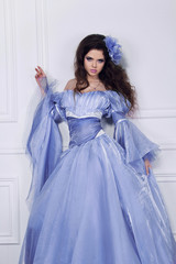 Beautiful woman with long hair wearing in luxury dress posing in