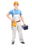 Full length portrait of a manual worker holding a tool box