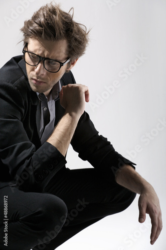 Fashion portrait of the  beautiful man over gray background