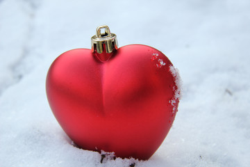 Heart shaped ornament in the snow