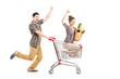 Young happy couple shopping, man pushing a shopping cart