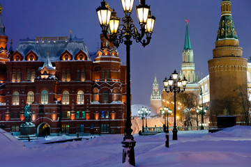 Kremlin towers in winter snowing evening, Moscow