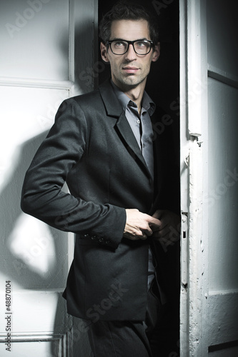Smart model wearing black suit