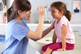Doctor Examining Child's Eyes In Doctor's Office - Fine Art prints