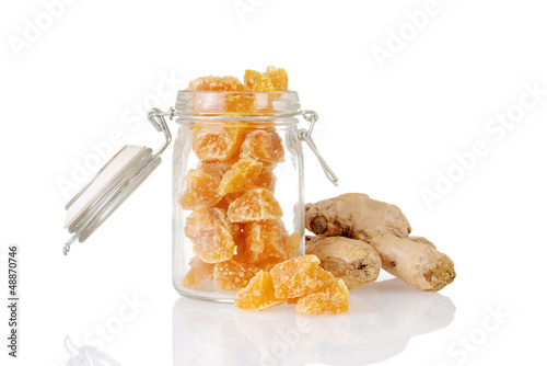 candied ginger in a jar with root
