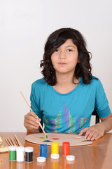 Young girl mixing art paints
