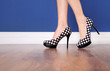 canvas print picture - Woman wearing polka dot high heels