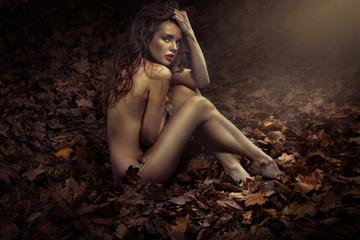 Naked pretty princess among leaves