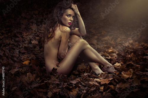 Naked pretty princess among leaves