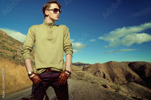 Fashion photo shot of a man wearing gloves