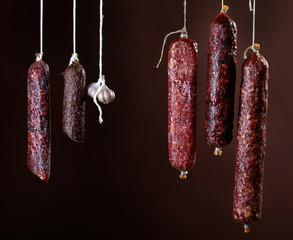 various hanging salami sausages