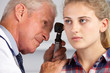Doctor Examining Teenage Girl's Ears