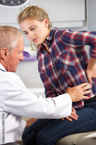 Teenage Girl Visits Doctor's Office With Back Pain