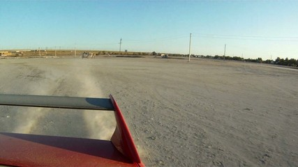Red car speed drift on sand