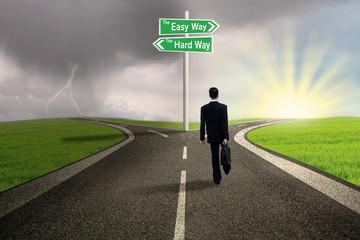 Businessman choosing easy way