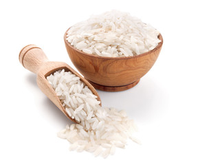 long grain rice in a wooden bowl isolated on white