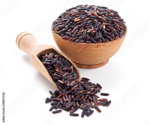 black rice in a wooden bowl isolated on white