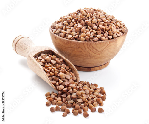 Fotobehang Granen buckwheat in a wooden bowl isolated on white