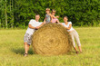 The family outdoors has rest on hay