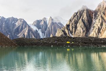 Tent on bank of mountain lake