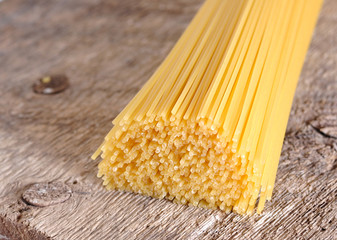 raw pasta on wood background texture