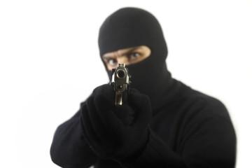 Robber points a gun
