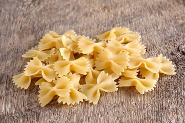raw pasta on wood background texture