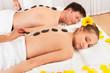 Couple having a hot stone massage