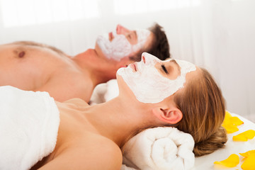Man and woman in face masks